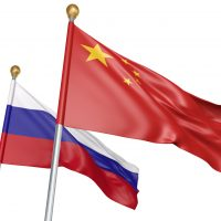 Isolated China and Russia flags flying together for diplomatic talks and trade relations